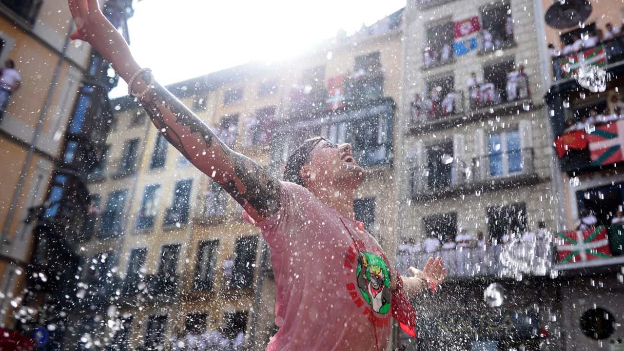 A revellers reacts after being splashed with water before the opening of the San Fermin festival in Pamplona, Spain. (Image: Reuters)