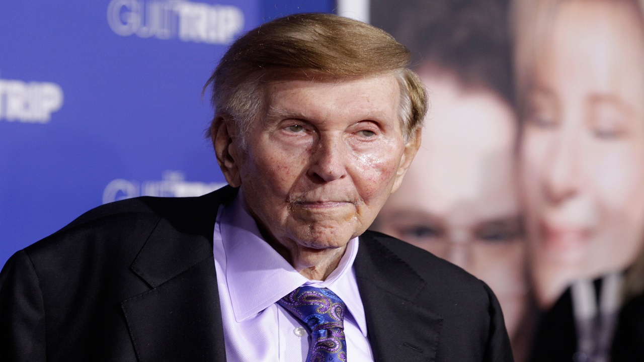 Q11. Identify the person in the picture who remains controlling shareholder of both CBS and the beleaguered Viacom? (Image: Reuters)