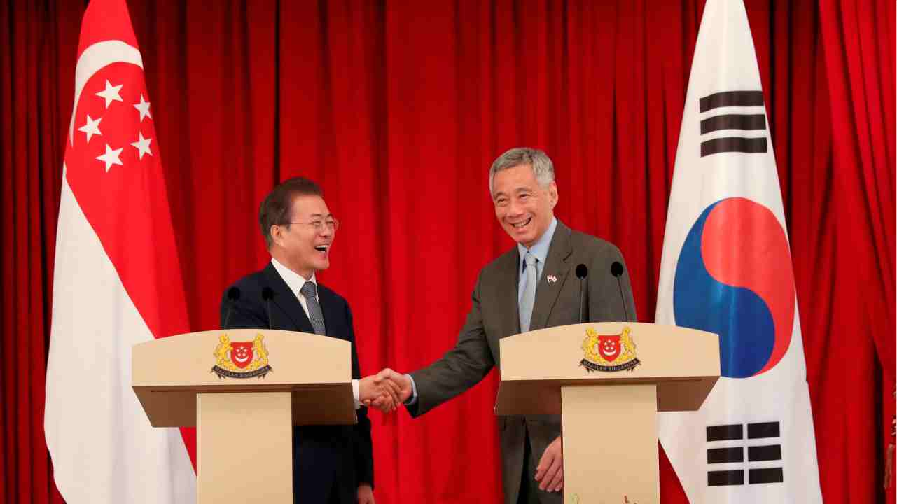 Singapore's Prime Minister Lee Hsien Loong shakes hands with South Korea's President Moon Jae-in at the Istana in Singapore. (Reuters)
