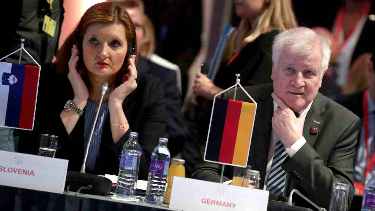Slovenia's Interior Minister Vesna Gyorkos Znidar and Germany's Interior Minister Horst Seehofer during an informal meeting of EU's Home Affairs Ministers in Innsbruck, Austria. (Reuters)