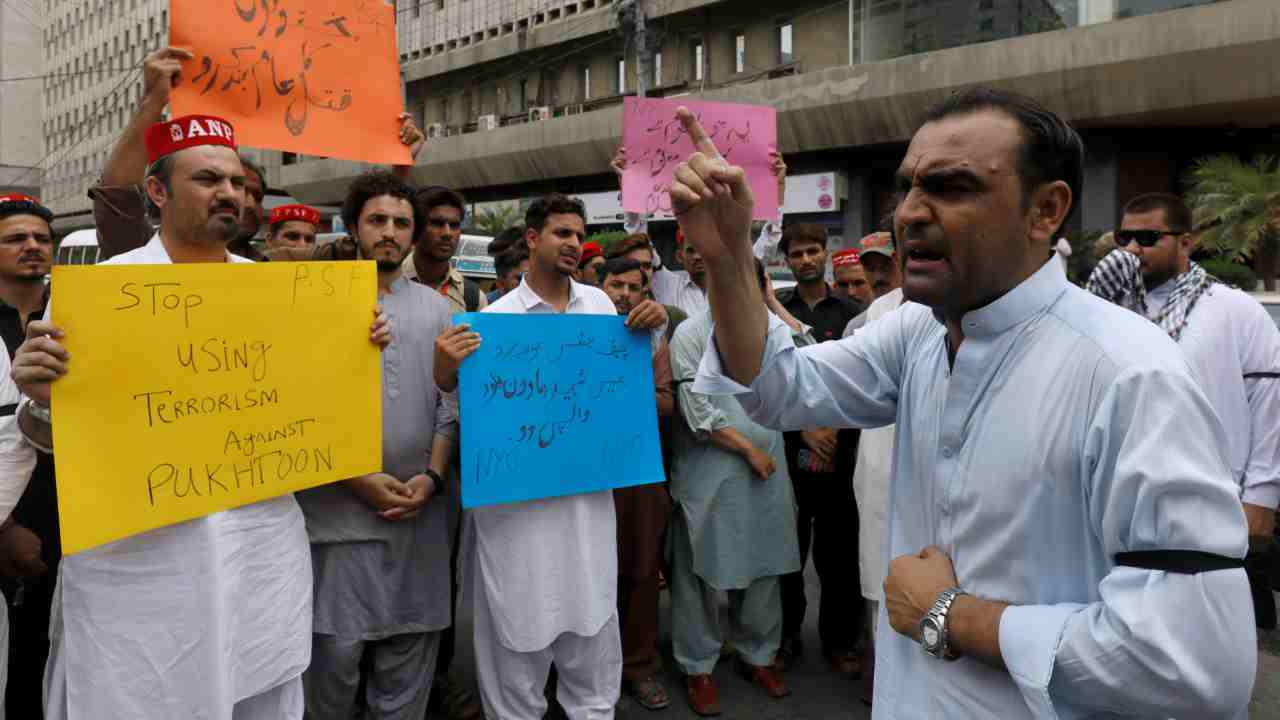 Activists of Awami National Party (ANP) political party, hold signs as they chant slogans to condemn Tuesday's suicide attack during an election campaign meeting in Peshawar, at a protest in Karachi, Pakistan. (Reuters)