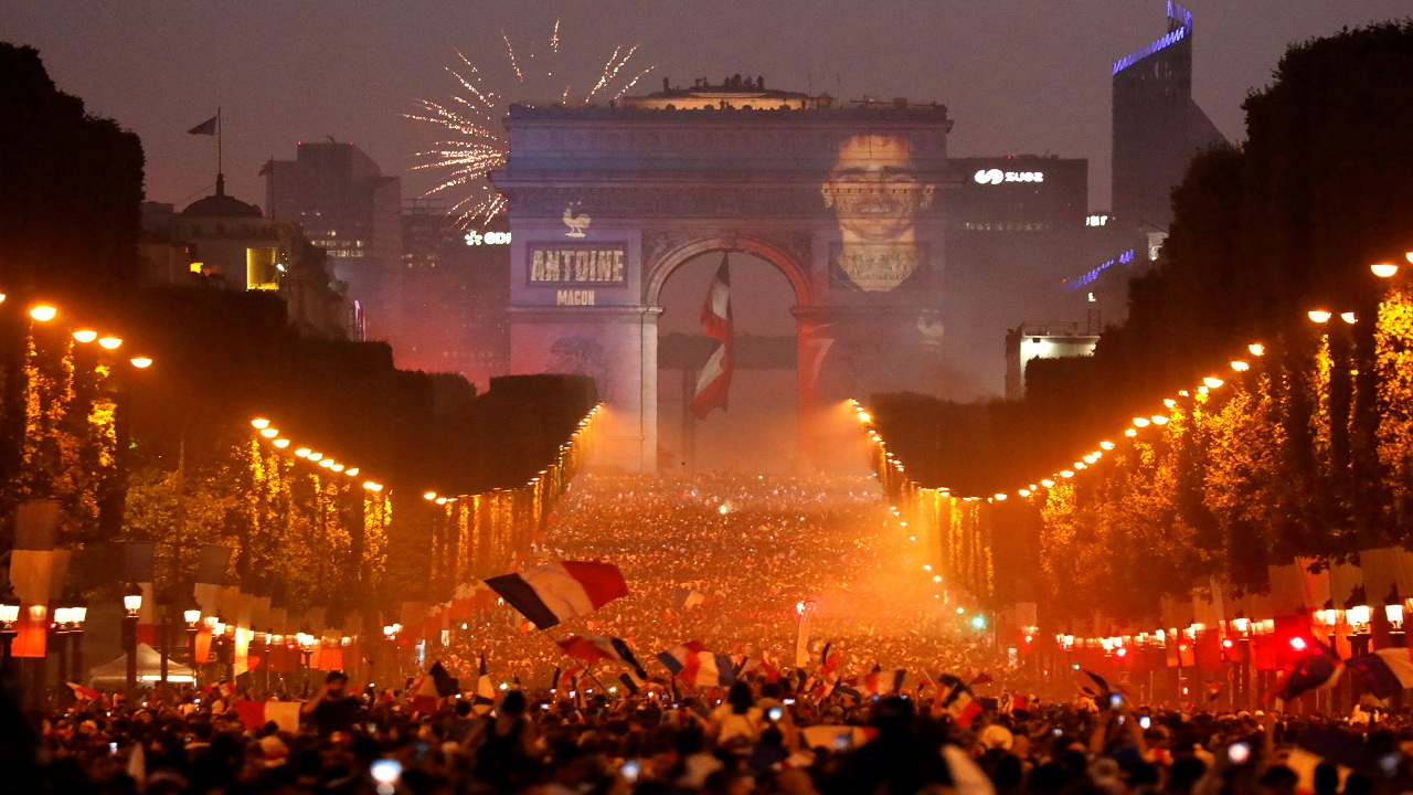 A giant picture of France's Antoine Griezmann is seen on the Arc de Triomphe as France fans celebrate on the Champs-Elysees Avenue after France won the Soccer World Cup final. (Image: Reuters)