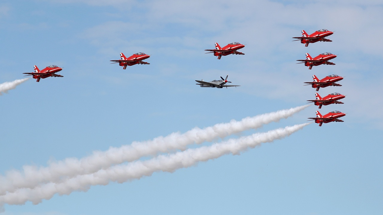 The Red Arrows, Royal Air Force Aerobatic Team, are joined by a Spitfire at the opening of the Farnborough Airshow, in Farnborough, Britain. (Image: Reuters)