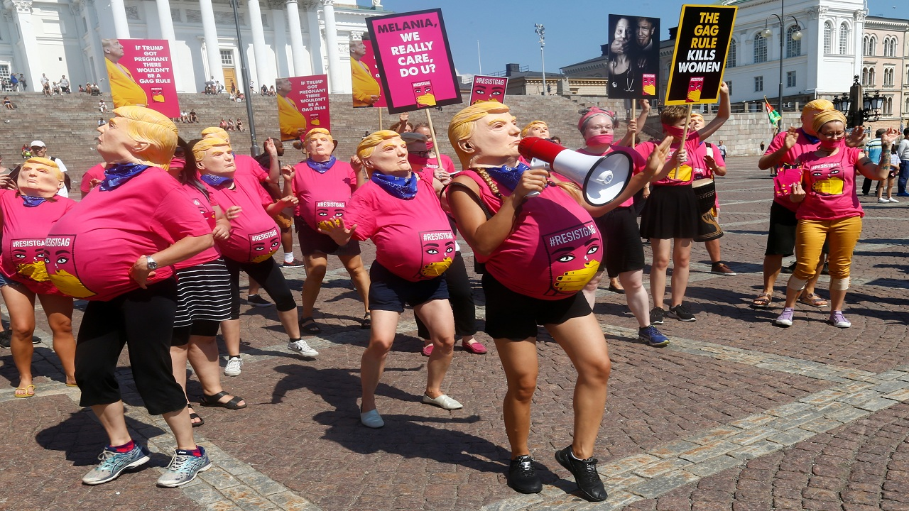 People depicting a pregnant U.S. president Donald Trump, attend a protest at Senate Square to support women's reproductive rights.President Trump and Russian President Vladimir Putin are meeting at a summit in Helsinki, Finland (Image: Reuters).