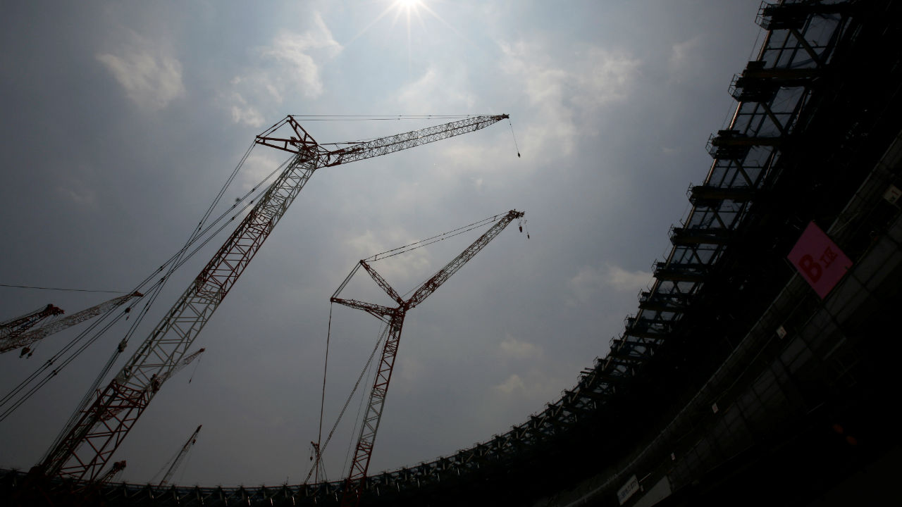 Construction site of the New National Stadium, the main stadium of Tokyo 2020 Olympics and Paralympics, is seen under the light of the sun during a heat wave in Tokyo, Japan. (REUTERS)