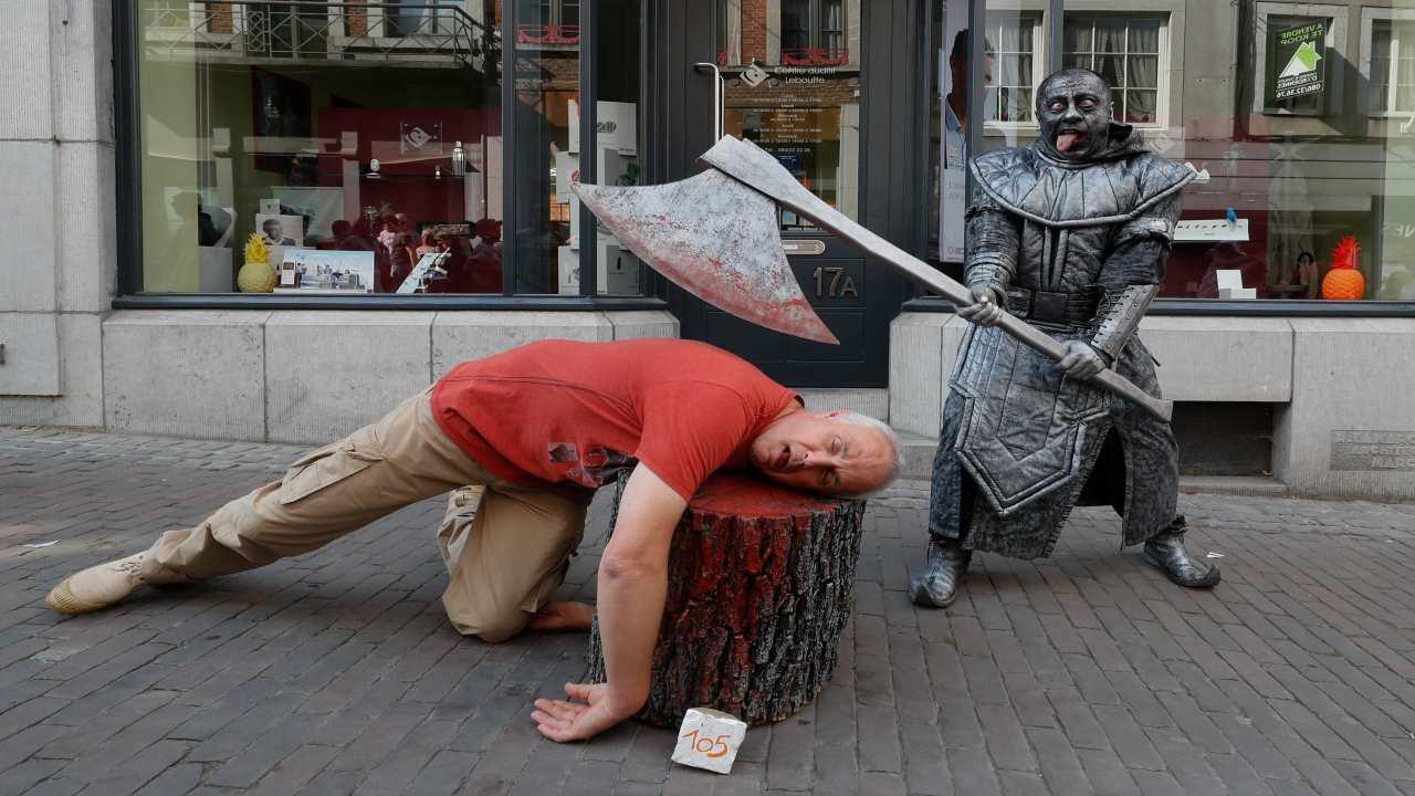 """An artist called """"Le Bourreau/The Headsman"""" takes part in the festival """"Statues en Marche"""" in Marche-en-Famenne, Belgium. (Image: REUTERS)"""