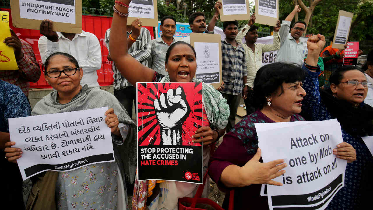 People shout anti-government slogans during a protest against what the demonstrators say are recent mob lynchings across the country, in Ahmedabad, India. (REUTERS)