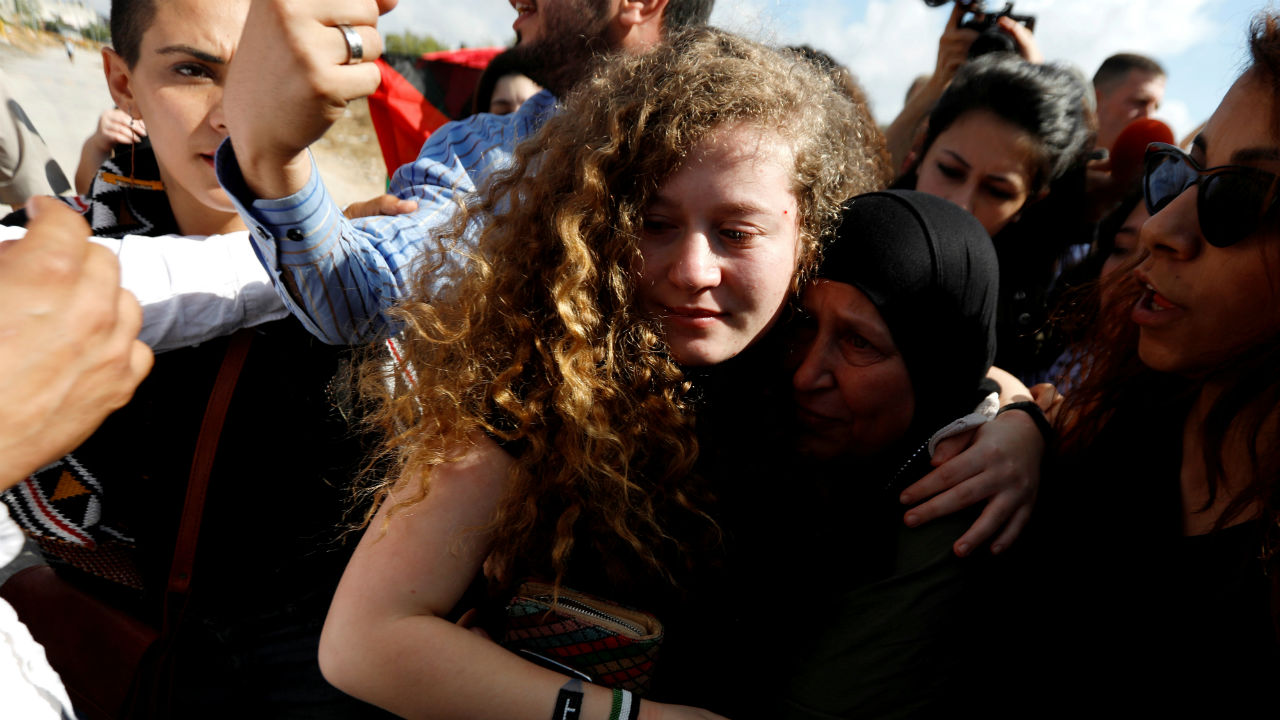 Palestinian teenager Ahed Tamimi is welcomed by relatives and supporters after she was released from an Israeli prison, at Nabi Saleh village in the occupied West Bank. (Image: Reuters)