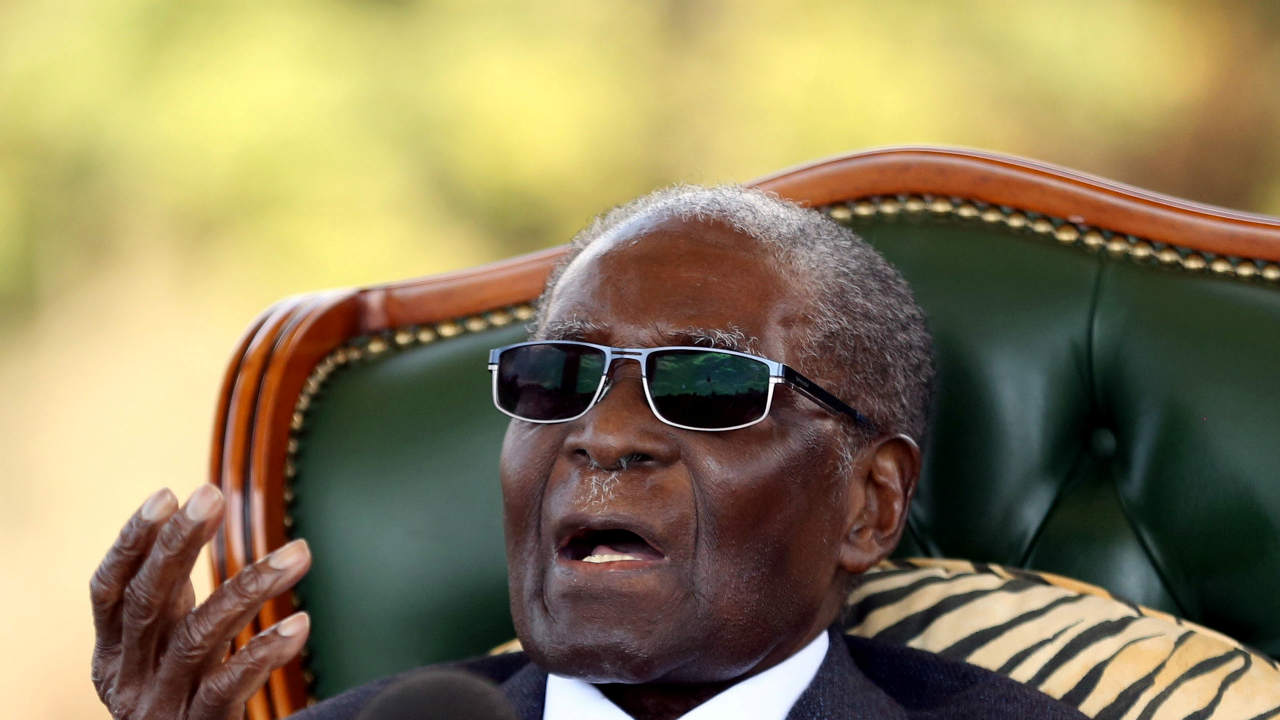 "Zimbabwe's former president Robert Mugabe gestures during a news conference at his private residence nicknamed ""Blue Roof"" in Harare, Zimbabwe. (REUTERS)"