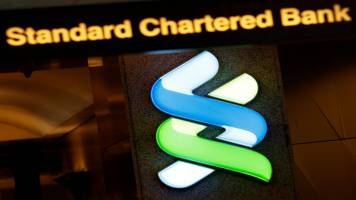 Standard Chartered sets aside $900 million to cover US, British fines