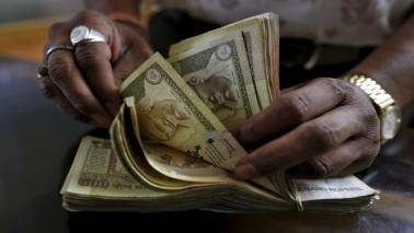 Indan rupee down 2 paise to 68.47 against dollar