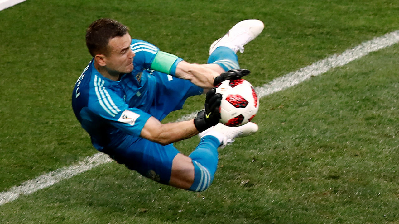 Russia's Igor Akinfeev saves the penalty of Spain's Koke during the shootout. (Image - Reuters)