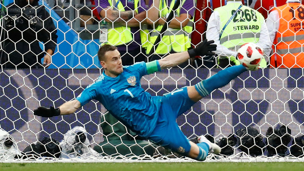 Russia's Igor Akinfeev saves the penalty from Spain's Iago Aspas during the shootout giving Russia a 4-3 win on penalties. (Image - Reuters)