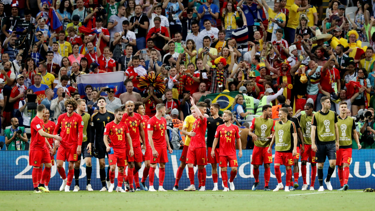 Belgium players celebrate in front of their fans after the match. (Image – Reuters)