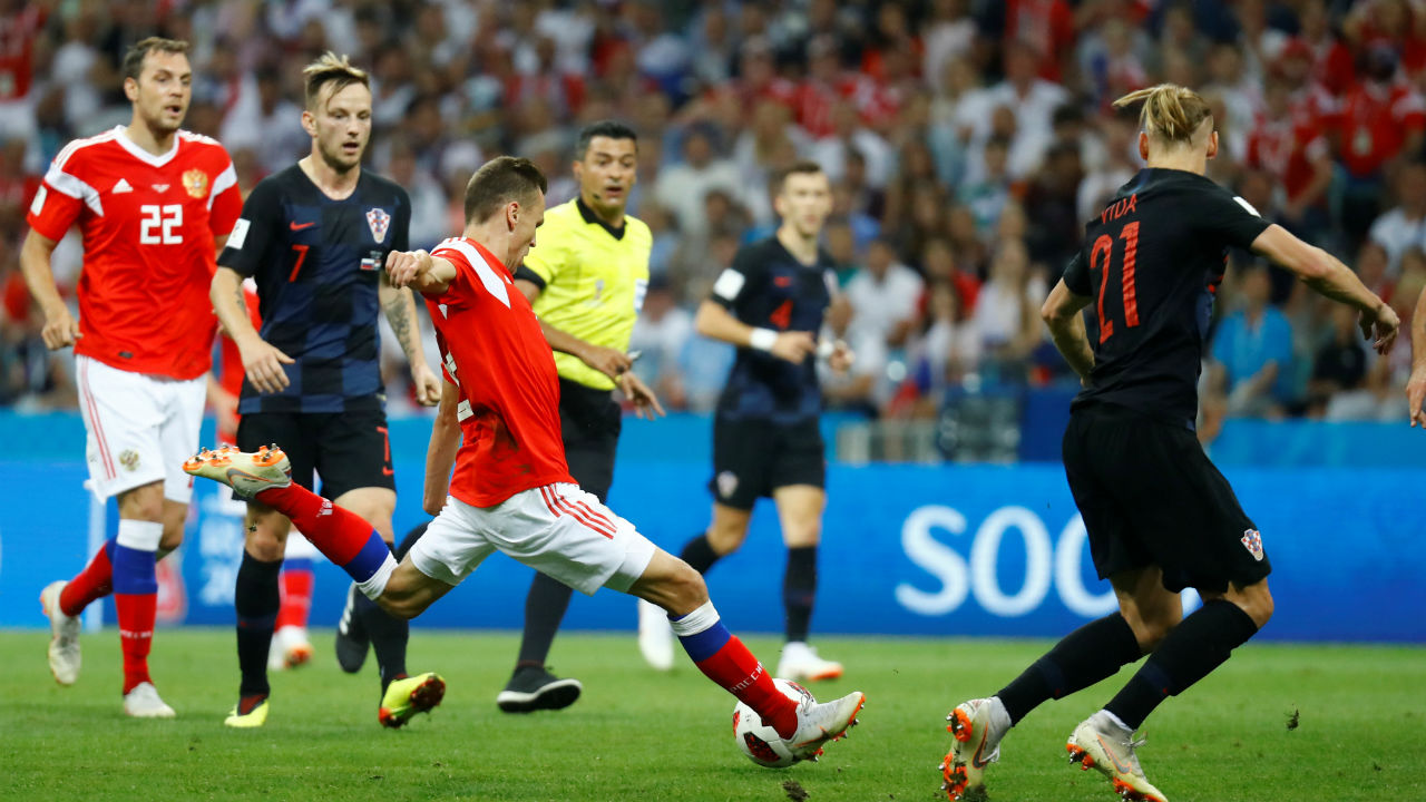 Russia 1-0 Croatia | In the 31st minute, Russia's Denis Cheryshev played a quick one-two with Artem Dzyuba before sending the ball into the back of the net with a sensational strike from 20 yards out. (Image – Reuters)