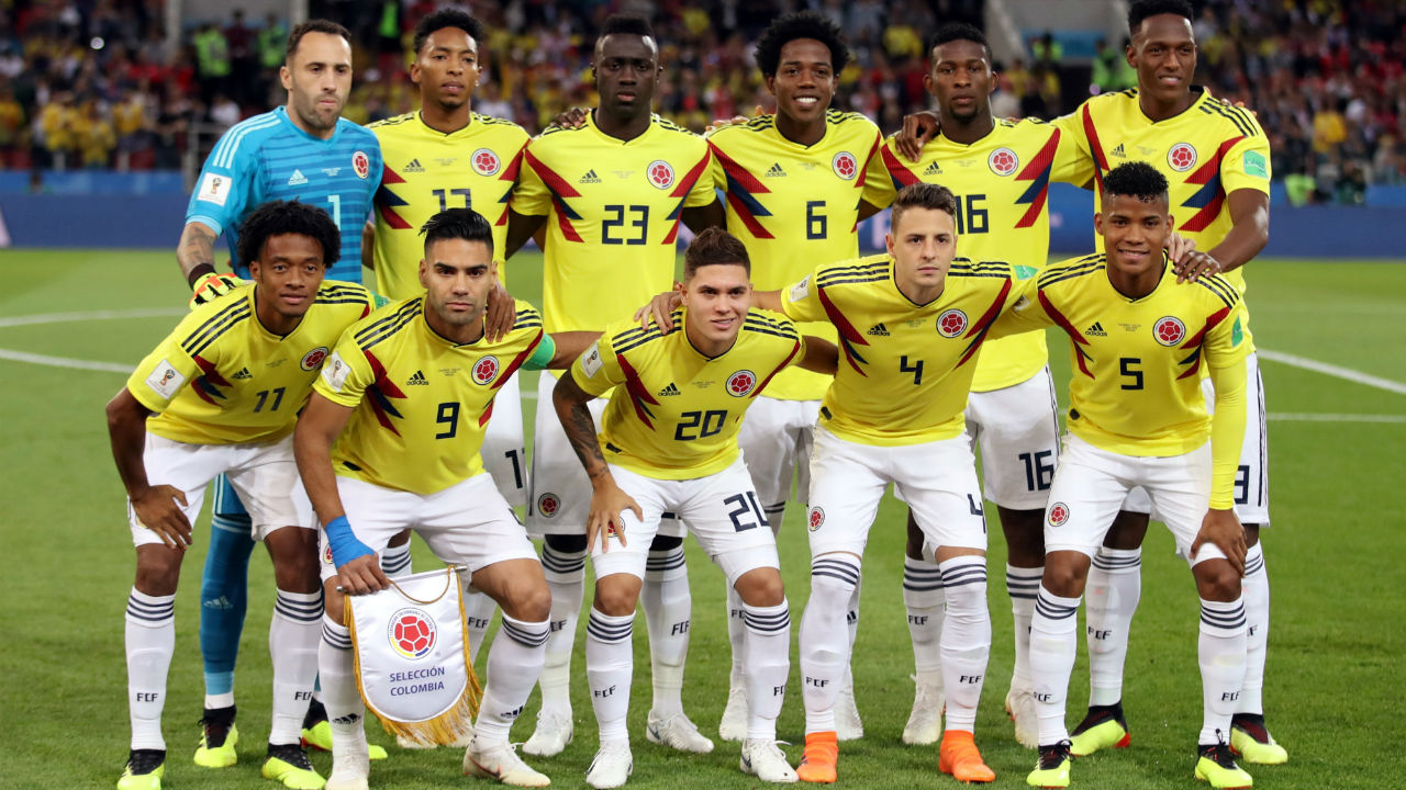 Colombia players pose for a team group photo before the match. (Image – Reuters)
