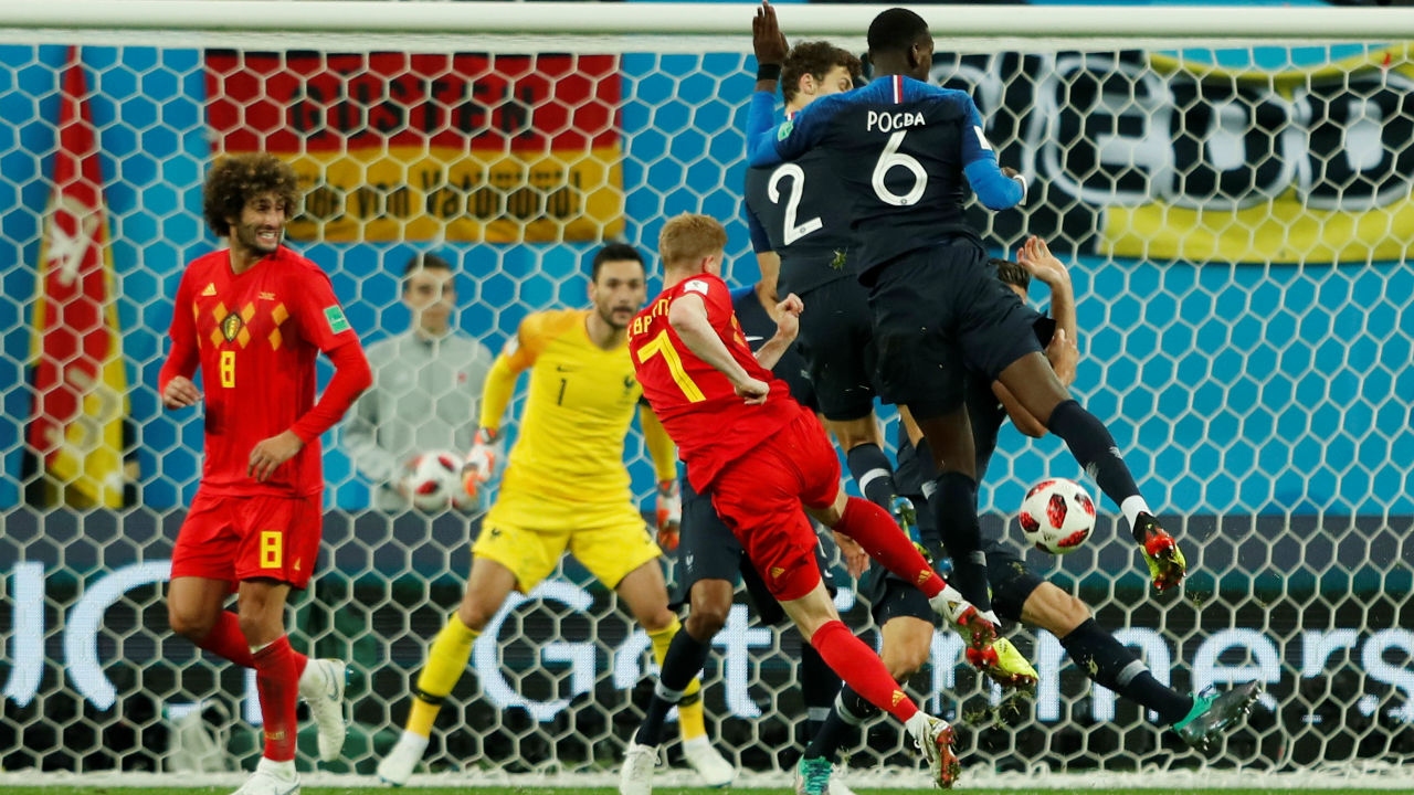Belgium's Kevin De Bruyne shoots at goal as France's Paul Pogba and Benjamin Pavard attempt to block. Belgium continued to look for an equaliser but France defended in numbers making the task all the more difficult for the 'Red Devils'.