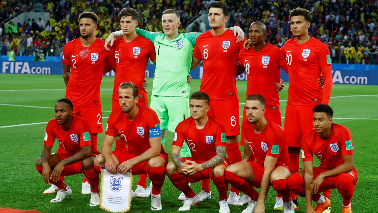 England players pose for a team group photo before the match. (Image – Reuters)