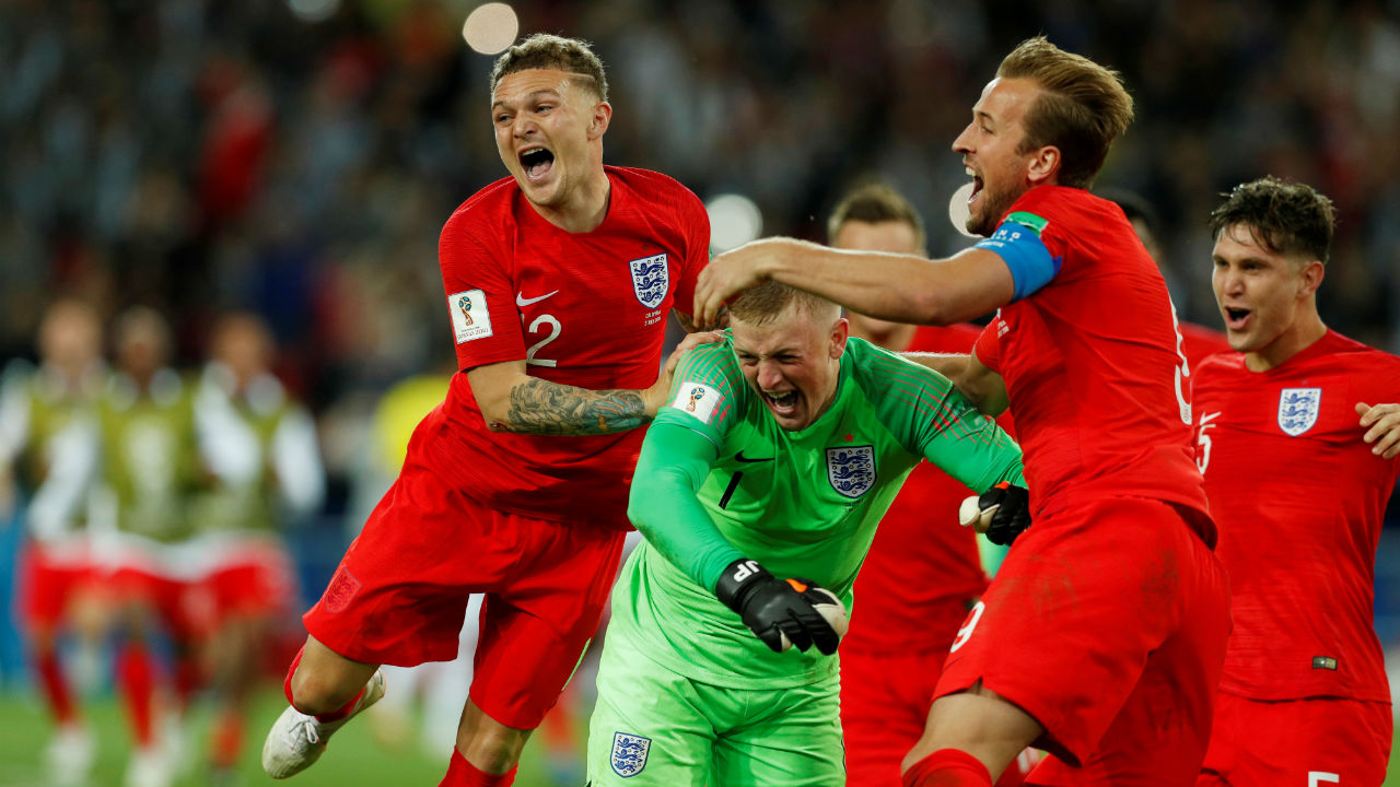 England's Jordan Pickford celebrates with team mates after they beat Colombia 4-3 via penalties to secure a place in the quarter-finals of the tournament. (Image – Reuters)