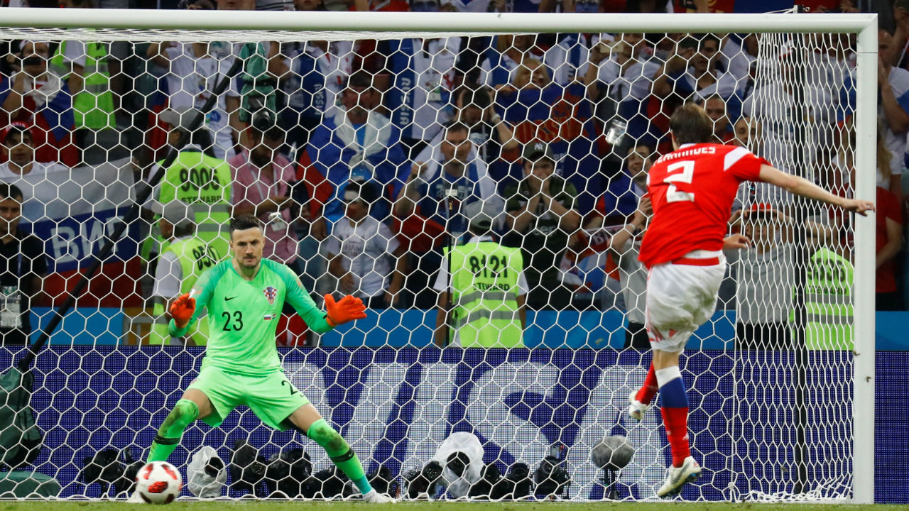 Missed | Russia's Mario Fernandes dragged his penalty wide as he aimed for the bottom left corner. (Image – Reuters)