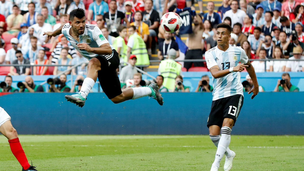 Argentina's Sergio Aguero scores their third goal when he headed in Messi's cross into the area late in stoppage time. (Image: Reuters)
