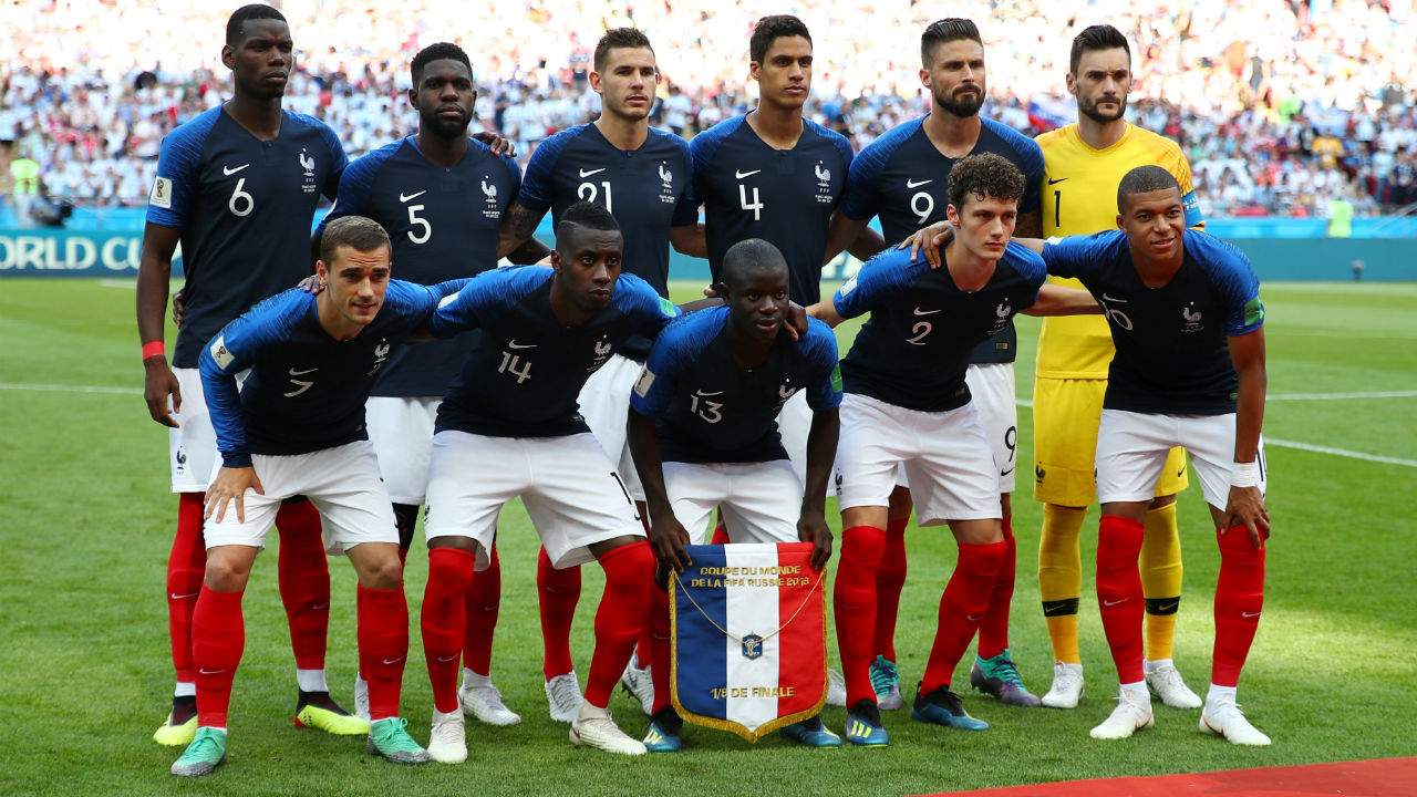 France players pose for a team group photo before the match.