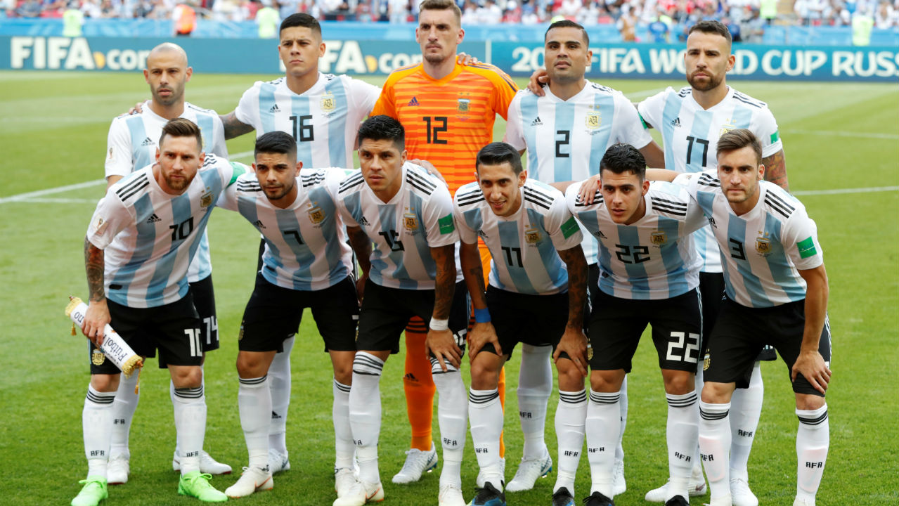 Argentina players pose for a team group photo before the match.
