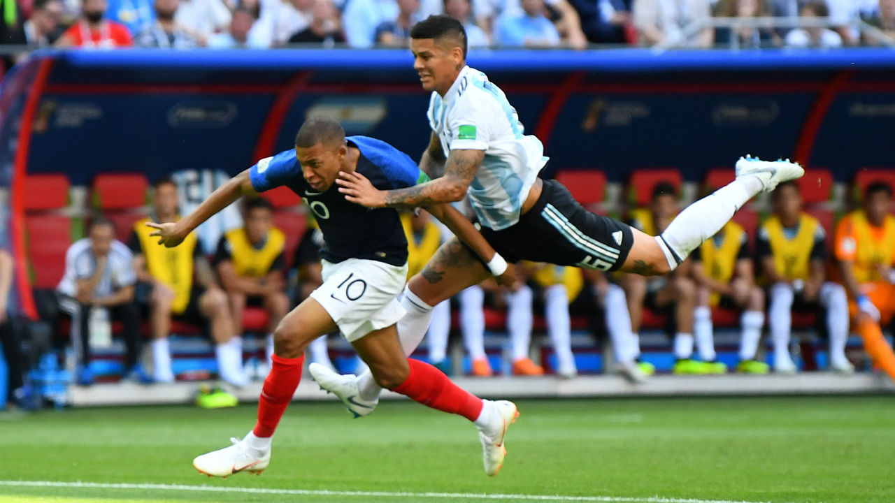 Argentina's Marcos Rojo fouls France's Kylian Mbappe in the penalty area leading to France's first goal from the penalty spot which Antoine Griezmann scored. (Image: Reuters)