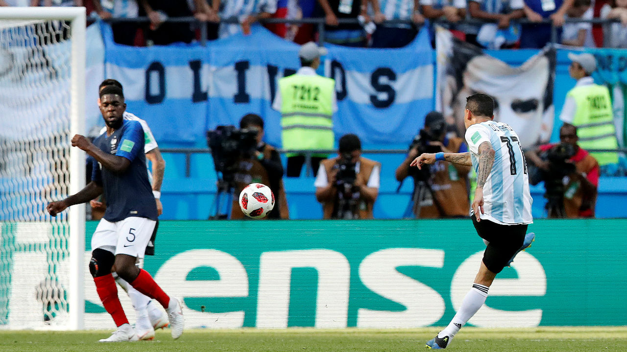 Argentina's Angel Di Maria scores their first goal, a long range shot that curled into the top right corner. (Image: Reuters)