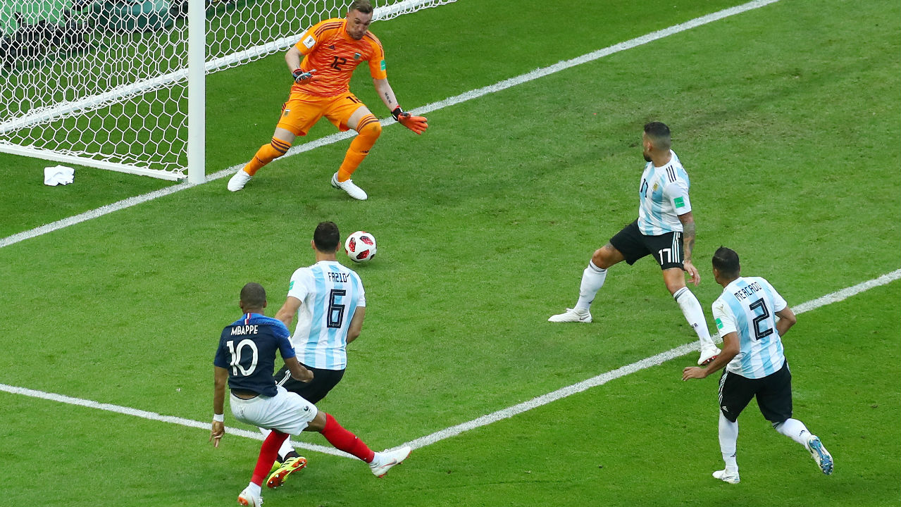 France's Kylian Mbappe scores their third goal, pushing the ball past his marker and lashing a low shot past keeper Franco Armani. (Image: Reuters)
