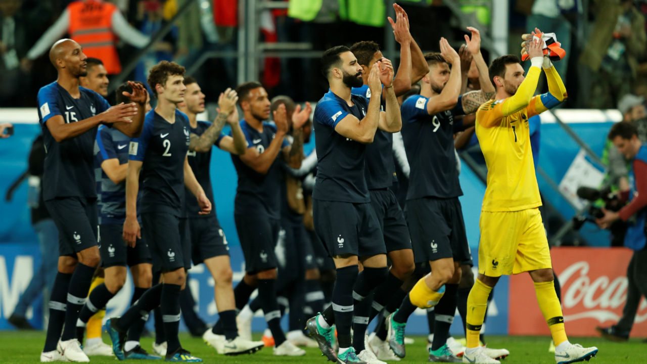 France's Hugo Lloris, Adil Rami and team mates applaud the fans at the end of the match.
