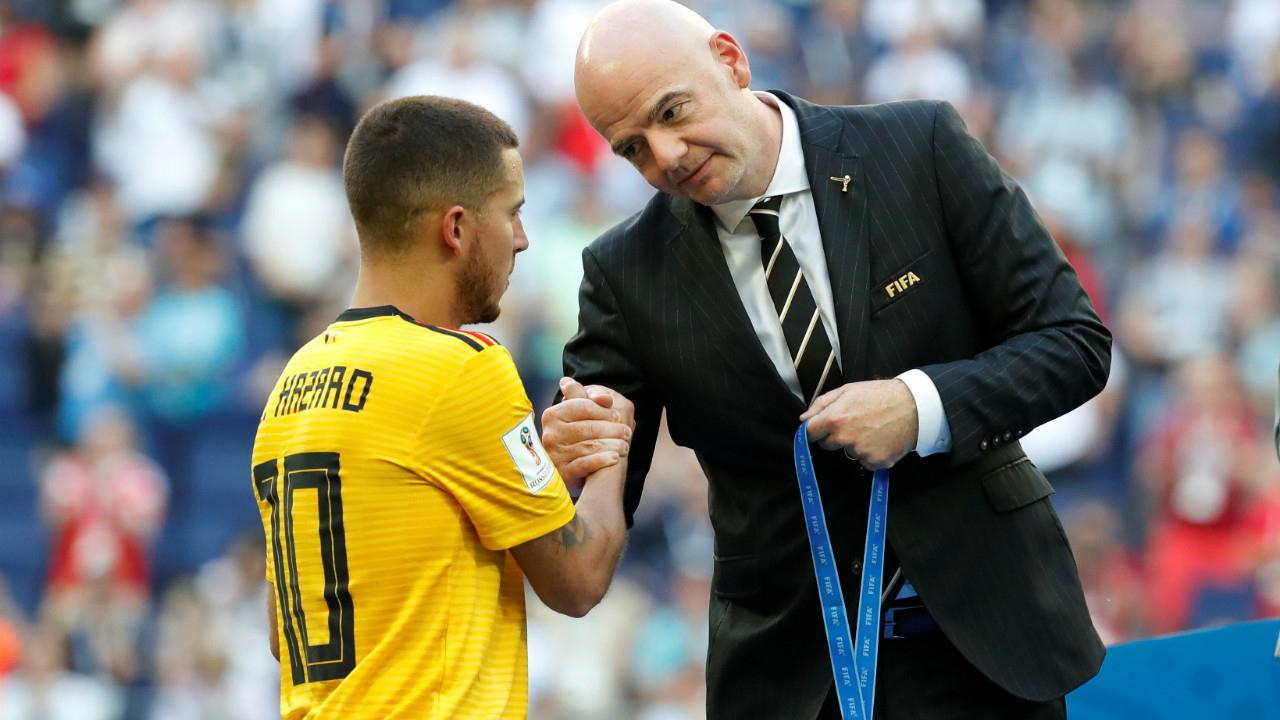 Belgium's Eden Hazard is presented a medal by FIFA president Gianni Infantino after the match. Hazard has been spectacular all through the tournament. He was directly involved in seven goals at the World Cup (three goals and four assists), the joint-most of any Belgium player since 1966. (Image – Reuters)