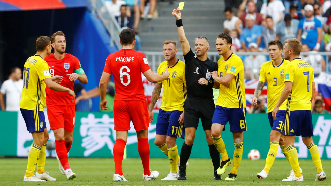 England's Harry Maguire is shown the first yellow card of the game in the 87th minute. It was a pretty clean game with just two yellow cards issued as compared to the England vs Colombia game where eight yellow cards were shown. (Image – Reuters)