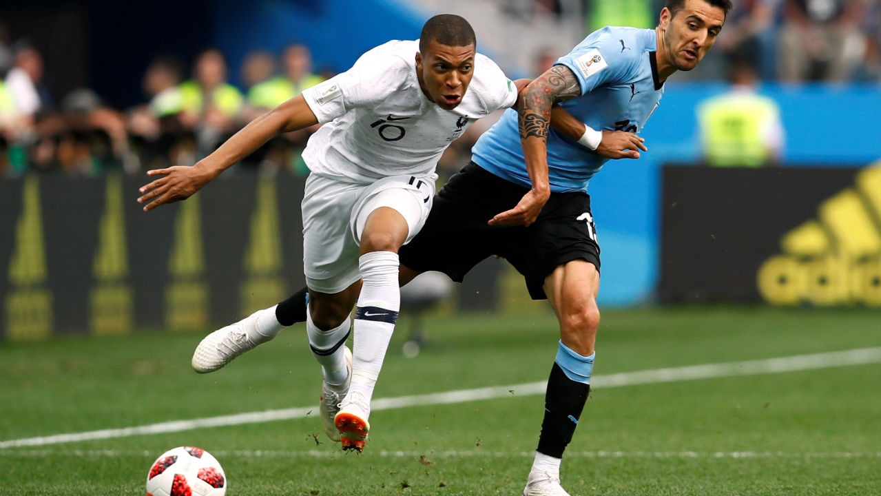 France's Kylian Mbappe in action with Uruguay's Matias Vecino. Mbappe has now completed a total of 21 take-ons in the World Cup, the third highest tally of the tournament behind only Messi and Isco who have completed 23 each. (Image – Reuters)