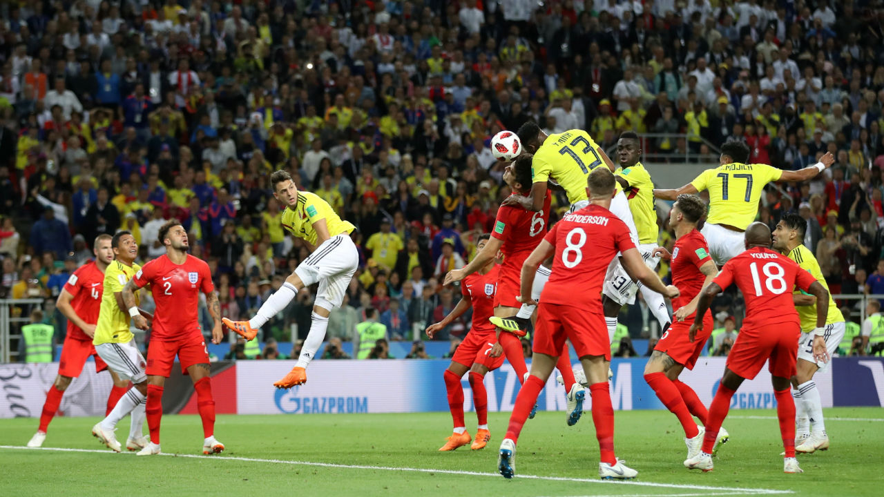 Colombia's Yerry Mina scores their first goal. He rose above Maguire and headed into the ground as the ball bounced over Trippier stationed at the post and found the roof of the net. (Image – Reuters)