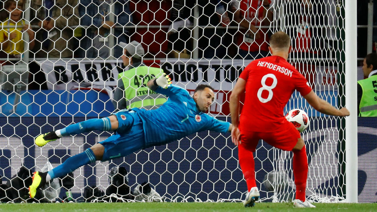 Colombia's David Ospina saves a penalty from England's Jordan Henderson during the penalty shootout. (Image – Reuters)