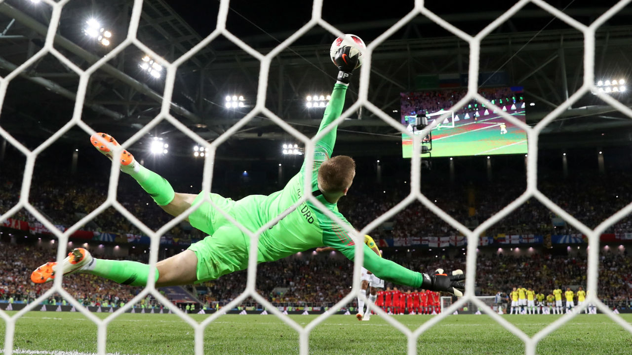 England's Jordan Pickford saves a penalty from Colombia's Carlos Bacca during the shootout. Bacca decided to go down the middle but Pickford who dived right extended his arm to make the save. (Image – Reuters)