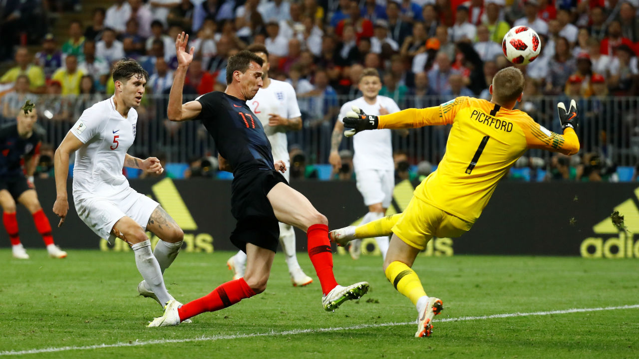 Save! | Ivan Perisic released Mario Mandzukic with a brilliant ball. Mandzukic had a clean strike at goal but somehow Jordan Pickford managed to rush out and make the save with his knee. (Image - Reuters)