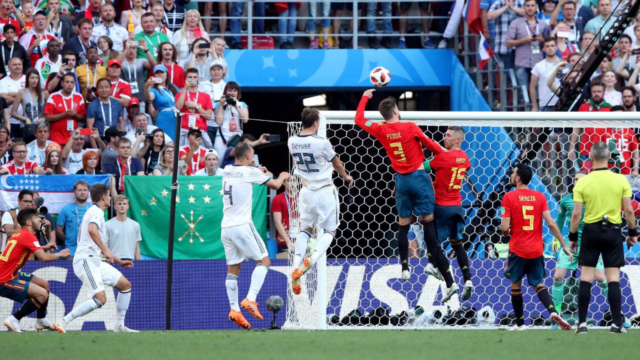 Spain's Gerard Pique handles the ball in the area resulting in a penalty being awarded to Russia. Dzyuba scored from the spot sending De Gea the wrong way. (Image - Reuters)