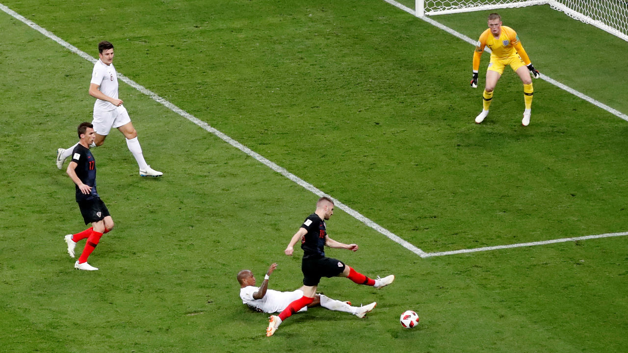 England's Ashley Young in action with Croatia's Ante Rebic. Rebic was played through on goal but Young did brilliantly to get back and put in a perfectly timed slide to block the shot. (Image - Reuters)