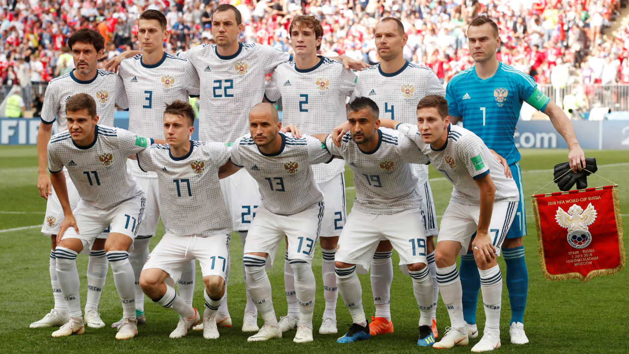 Russia players pose for a team group photo before the match. (Image - Reuters)