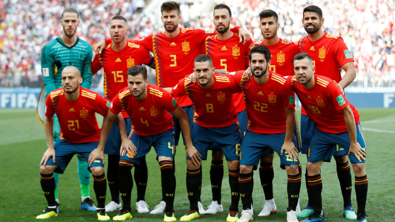 Spain players pose for a team group photo before the match.