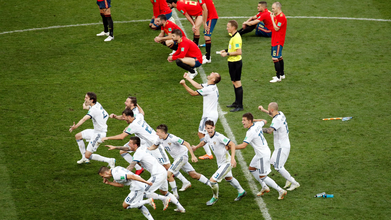 Russia players celebrate winning the penalty shootout. (Image - Reuters)