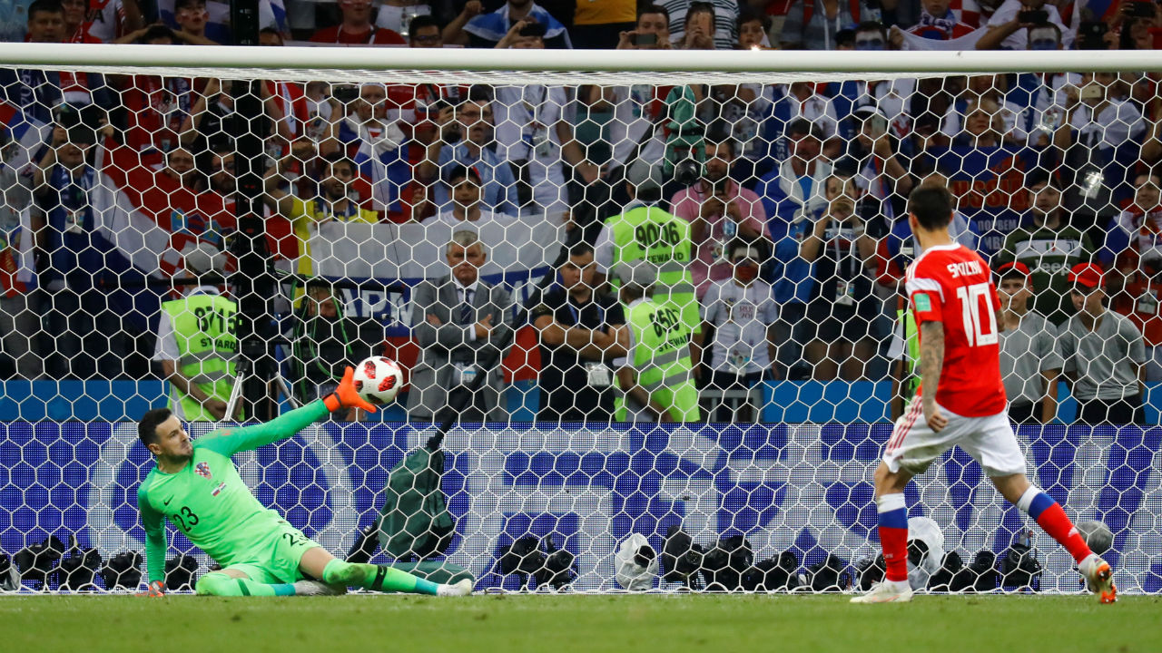 Saved | Russia saw their very first penalty saved as Danijel Subasic guessed the right way to save Fyodor Smolov's shot. (Image – Reuters)