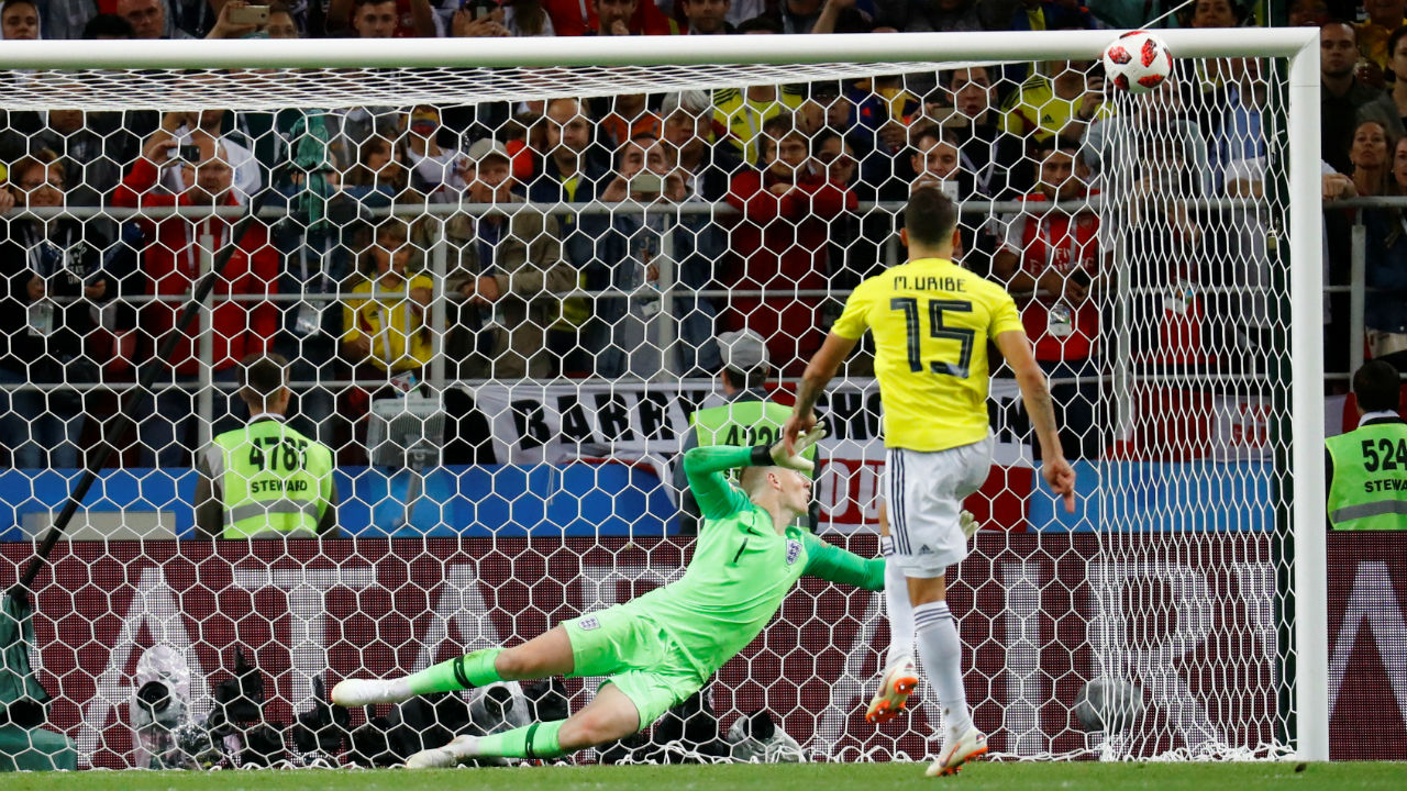 Colombia's Mateus Uribe misses a penalty during the shootout, his shot towards the top right corner hit the underside of the bar and bounced out. (Image – Reuters)