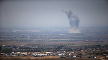 Syrian source says U.S.-led coalition fired at Syrian positions in east