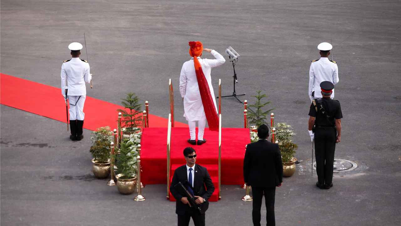 PM Narendra Modi salutes as he prepares to inspect the honour guard during Independence Day celebrations at the historic Red Fort in Delhi, India. (Reuters)
