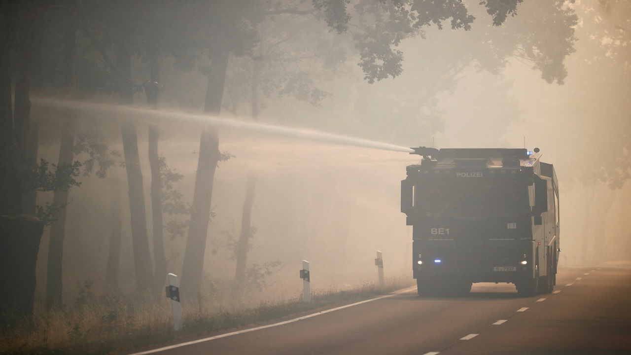 A police water cannon helps to put out a forest fire near Treuenbrietzen, Germany. (Image: Reuters)