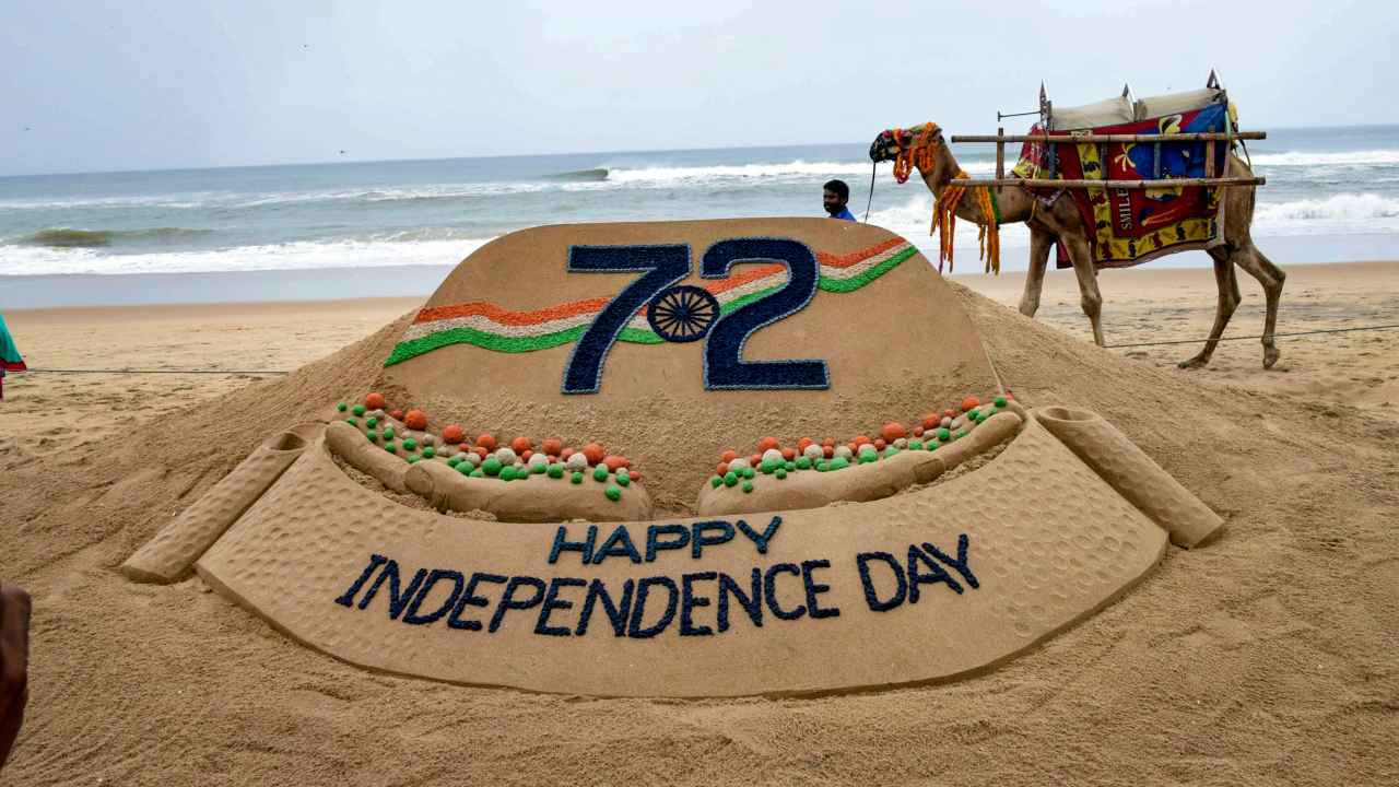 A creation by sand sculpting artist Sudarshan Pattanaik on the eve of Independence Day at a beach, in Puri. (PTI)