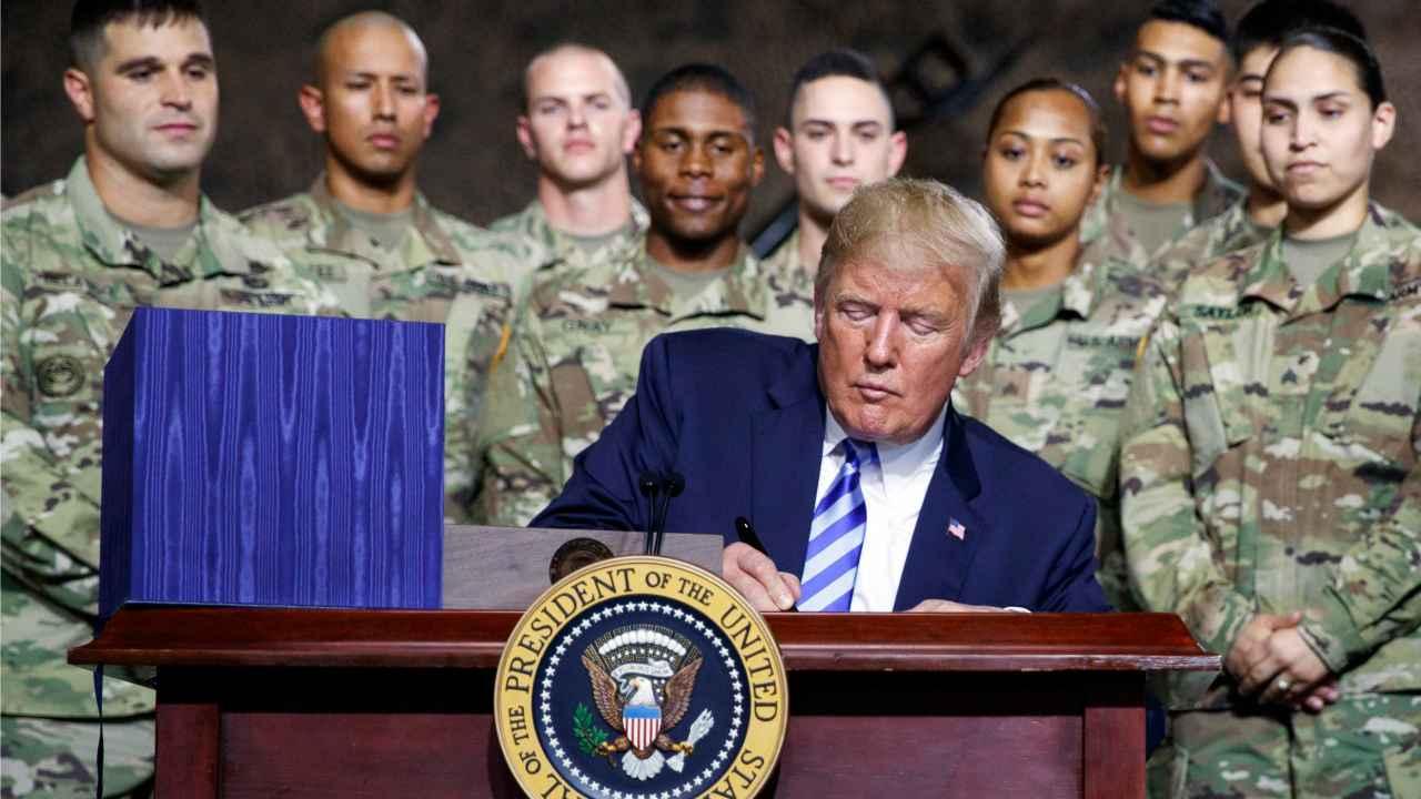 President Donald Trump signs the $716 billion defense policy bill named for Sen. John McCain at Fort Drum, NY. (AP/PTI)
